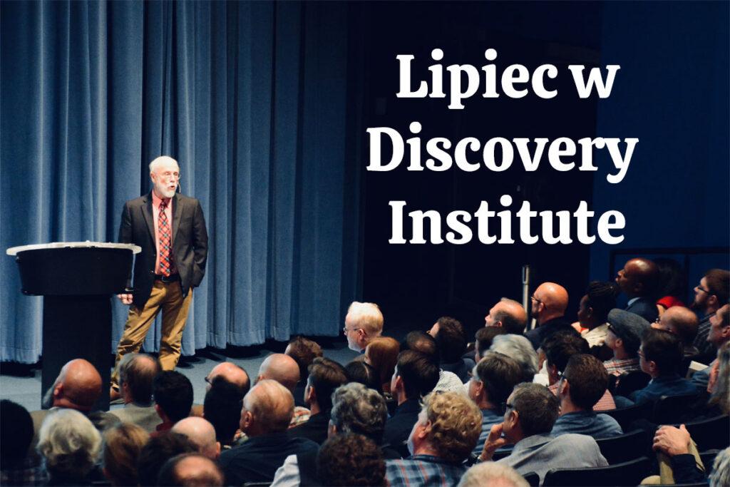 Wykładowca, Michael Behe, prowadzi wykład przed publicznością